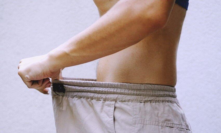 ผู้ชายเปิดกางเกง